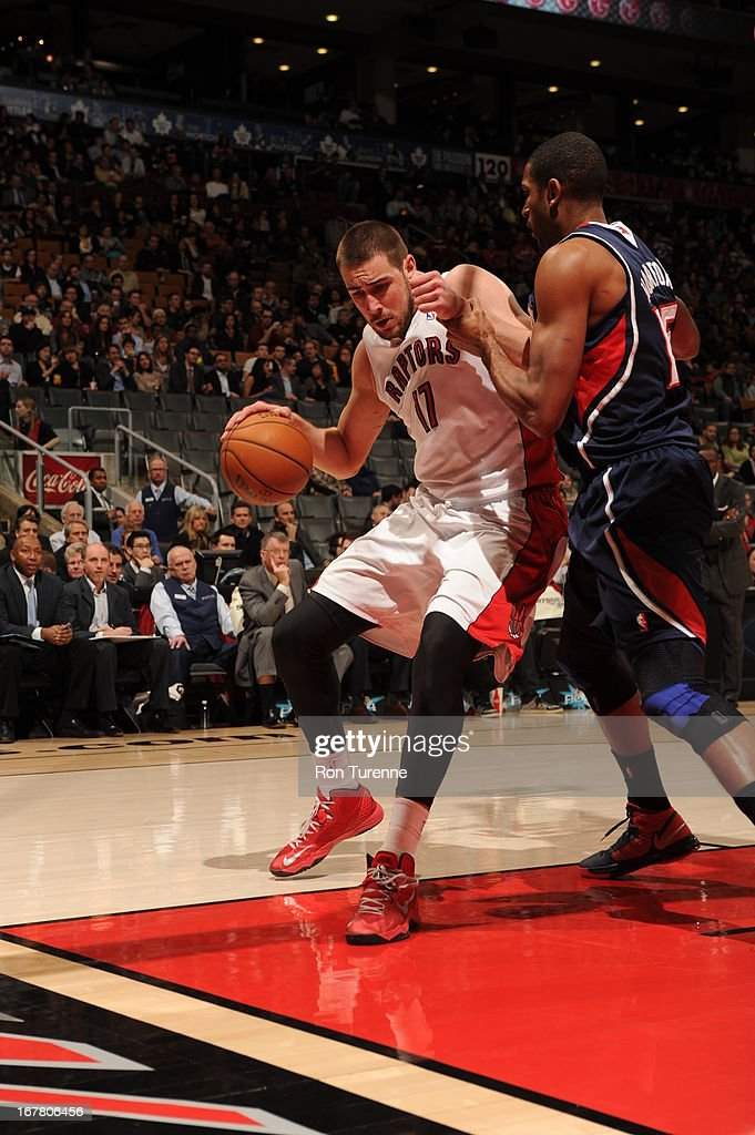 <a gi-track='captionPersonalityLinkClicked' href=/galleries/search?phrase=Jonas+Valanciunas&family=editorial&specificpeople=5654195 ng-click='$event.stopPropagation()'>Jonas Valanciunas</a> #17 of the Toronto Raptors drives to the basket against the Atlanta Hawks on March 27, 2013 at the Air Canada Centre in Toronto, Ontario, Canada.