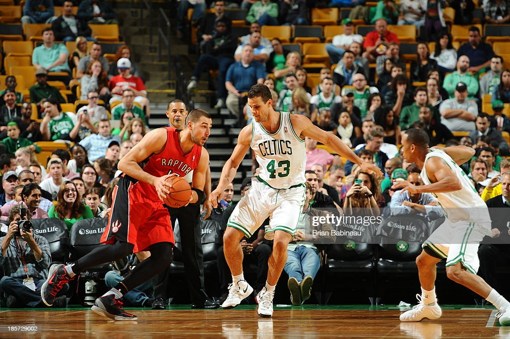 Jonas Valanciunas #17 of the Toronto Raptors drives to the basket against the Boston Celtics on October 7, 2013 at the TD Garden in Boston, Massachusetts.