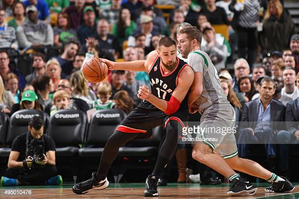 Jonas Valanciunas of the Toronto Raptors drives to the basket against David Lee of the Boston Celtics during the game on October 30 2015 at TD Garden...