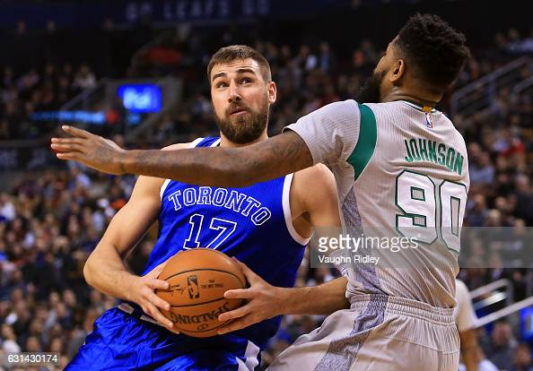 Jonas Valanciunas of the Toronto Raptors drives to the basket as Amir Johnson of the Boston Celtics defends during the first half of an NBA game at...