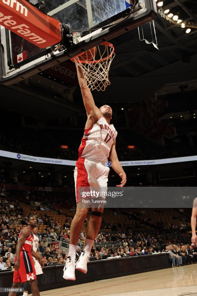 <a gi-track='captionPersonalityLinkClicked' href=/galleries/search?phrase=Jonas+Valanciunas&family=editorial&specificpeople=5654195 ng-click='$event.stopPropagation()'>Jonas Valanciunas</a> #17 of the Toronto Raptors dunks against the Washington Wizards during a pre-season game on October 17, 2012 at the Air Canada Centre in Toronto, Ontario, Canada.