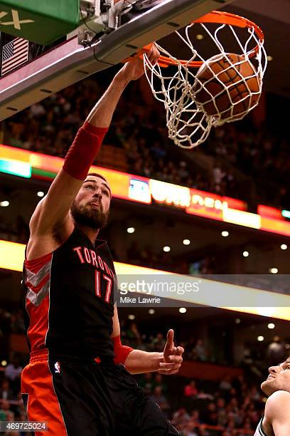 Jonas Valanciunas of the Toronto Raptors dunks in the first quarter against the Boston Celtics at TD Garden on April 14 2015 in Boston Massachusetts...