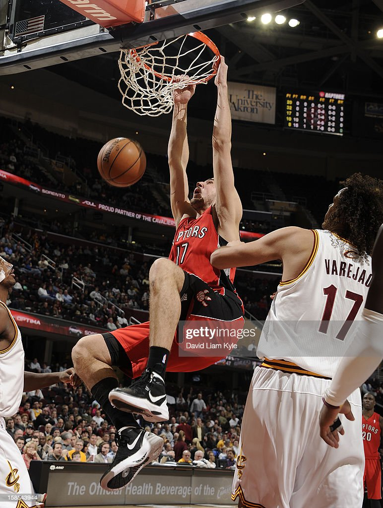 <a gi-track='captionPersonalityLinkClicked' href=/galleries/search?phrase=Jonas+Valanciunas&family=editorial&specificpeople=5654195 ng-click='$event.stopPropagation()'>Jonas Valanciunas</a> #17 of the Toronto Raptors dunks the ball against <a gi-track='captionPersonalityLinkClicked' href=/galleries/search?phrase=Anderson+Varejao&family=editorial&specificpeople=202247 ng-click='$event.stopPropagation()'>Anderson Varejao</a> #17 of the Cleveland Cavaliers at The Quicken Loans Arena on December 18, 2012 in Cleveland, Ohio.