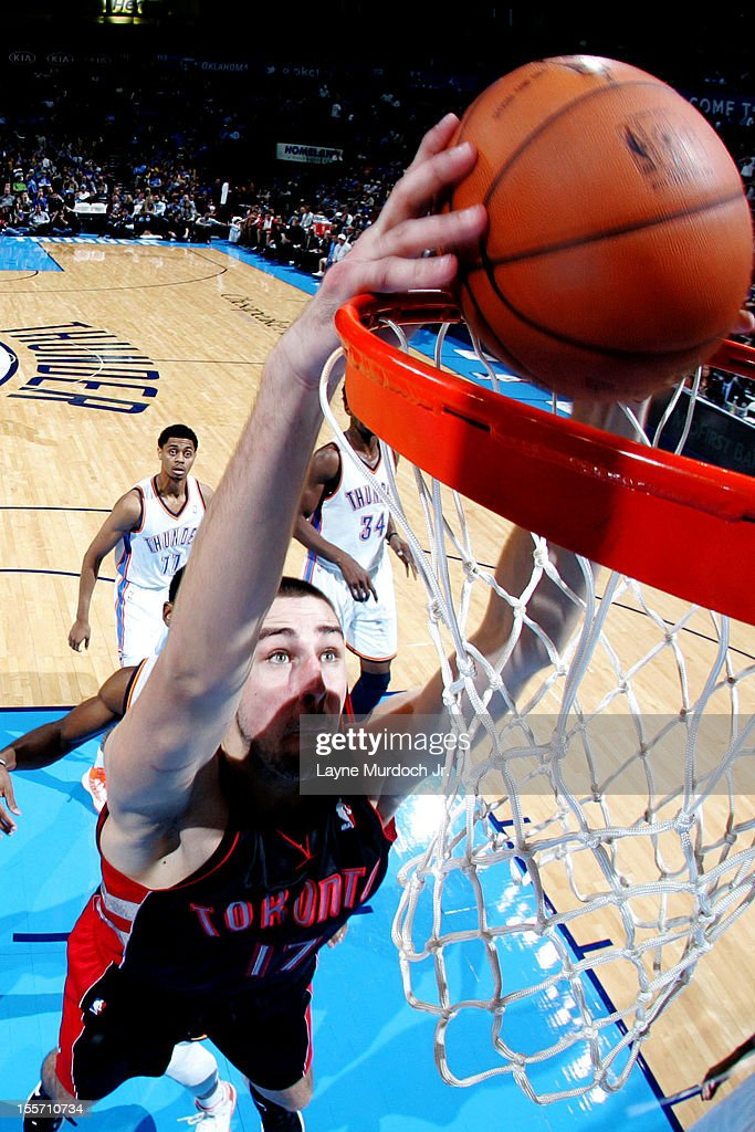 <a gi-track='captionPersonalityLinkClicked' href=/galleries/search?phrase=Jonas+Valanciunas&family=editorial&specificpeople=5654195 ng-click='$event.stopPropagation()'>Jonas Valanciunas</a> #17 of the Toronto Raptors dunks the ball against the Oklahoma City Thunder on November 6, 2012 at the Chesapeake Energy Arena in Oklahoma City, Oklahoma.