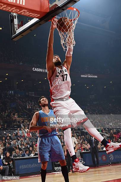 Jonas Valanciunas of the Toronto Raptors dunks the ball during the game against the Denver Nuggets on October 31 2016 at the Air Canada Centre in...