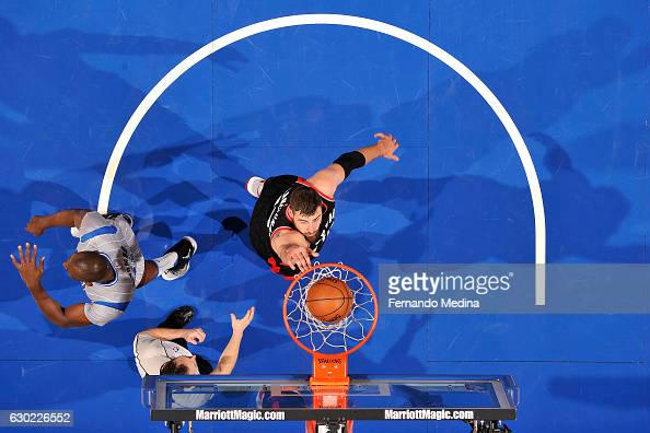 Jonas Valanciunas of the Toronto Raptors dunks the ball during the game against the Orlando Magic on December 18 2016 at Amway Center in Orlando...