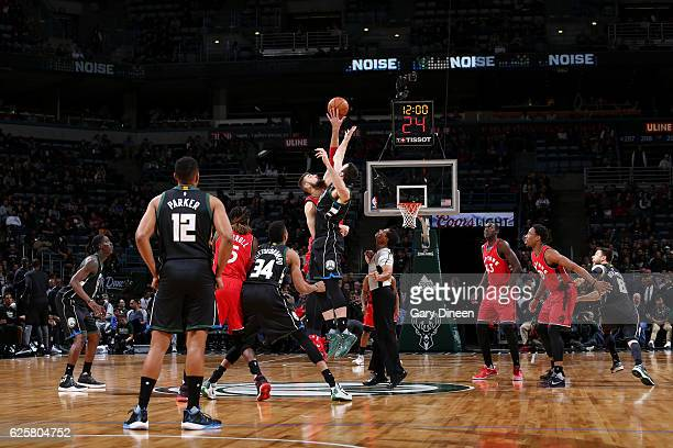 Jonas Valanciunas of the Toronto Raptors goes for the tip off against the Milwaukee Bucks during the game on November 25 2016 at the BMO Harris...