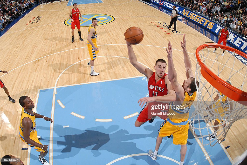 Jonas Valanciunas #17 of the Toronto Raptors goes in for the layup versus the Denver Nuggets on December 3, 2012 at the Pepsi Center in Denver, Colorado.