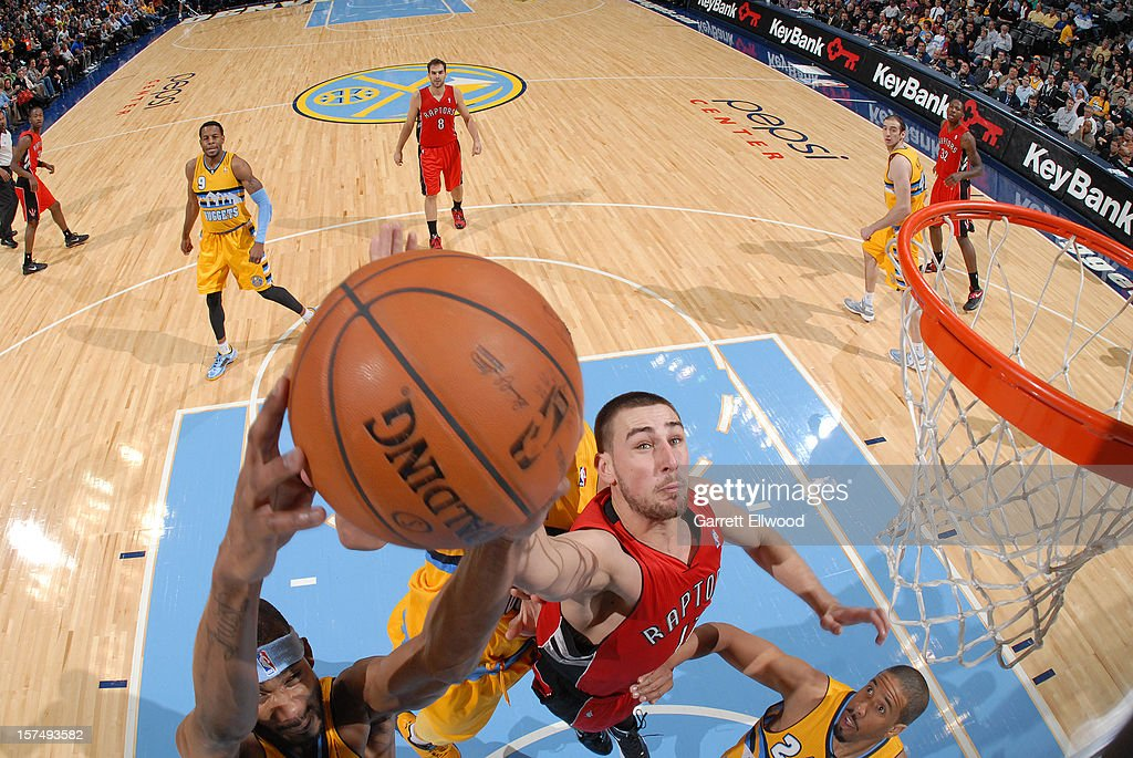 Jonas Valanciunas of the Toronto Raptors goes in for the layup versus the Denver Nuggets on December 3, 2012 at the Pepsi Center in Denver, Colorado.