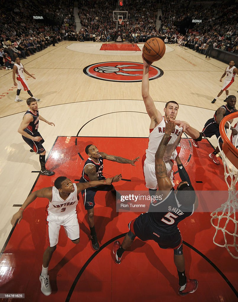 <a gi-track='captionPersonalityLinkClicked' href=/galleries/search?phrase=Jonas+Valanciunas&family=editorial&specificpeople=5654195 ng-click='$event.stopPropagation()'>Jonas Valanciunas</a> #17 of the Toronto Raptors goes to the basket against <a gi-track='captionPersonalityLinkClicked' href=/galleries/search?phrase=Josh+Smith+-+Joueur+de+basketball+-+N%C3%A9+en+1985&family=editorial&specificpeople=201983 ng-click='$event.stopPropagation()'>Josh Smith</a> #5 of the Atlanta Hawks during the game between the Toronto Raptors and the Atlanta Hawks on March 27, 2013 at the Air Canada Centre in Toronto, Ontario, Canada.
