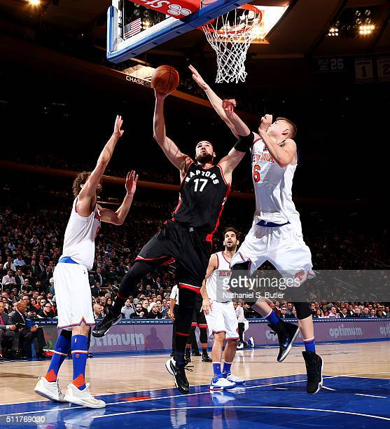 Jonas Valanciunas of the Toronto Raptors goes to the basket against Kristaps Porzingis of the New York Knicks on February 22 2016 at Madison Square...