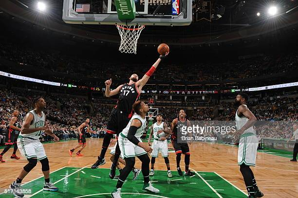 Jonas Valanciunas of the Toronto Raptors goes to the basket against the Boston Celtics on March 23 2016 at the TD Garden in Boston Massachusetts NOTE...