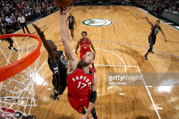 Jonas Valanciunas of the Toronto Raptors goes to the basket against the Milwaukee Bucks during Game Three of the Eastern Conference Quarterfinals of...