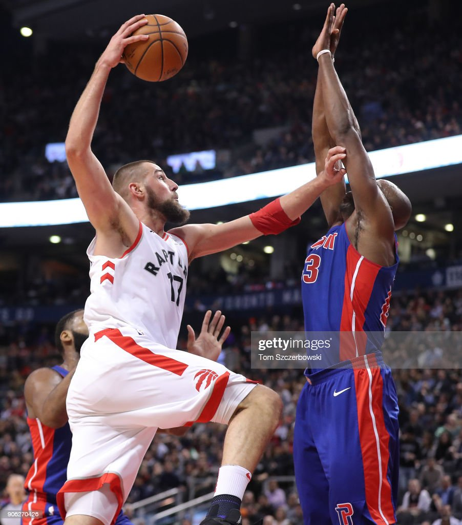 Jonas Valanciunas #17 of the Toronto Raptors goes to the basket against Anthony Tolliver #43 of the Detroit Pistons at Air Canada Centre on January 17, 2018 in Toronto, Canada.