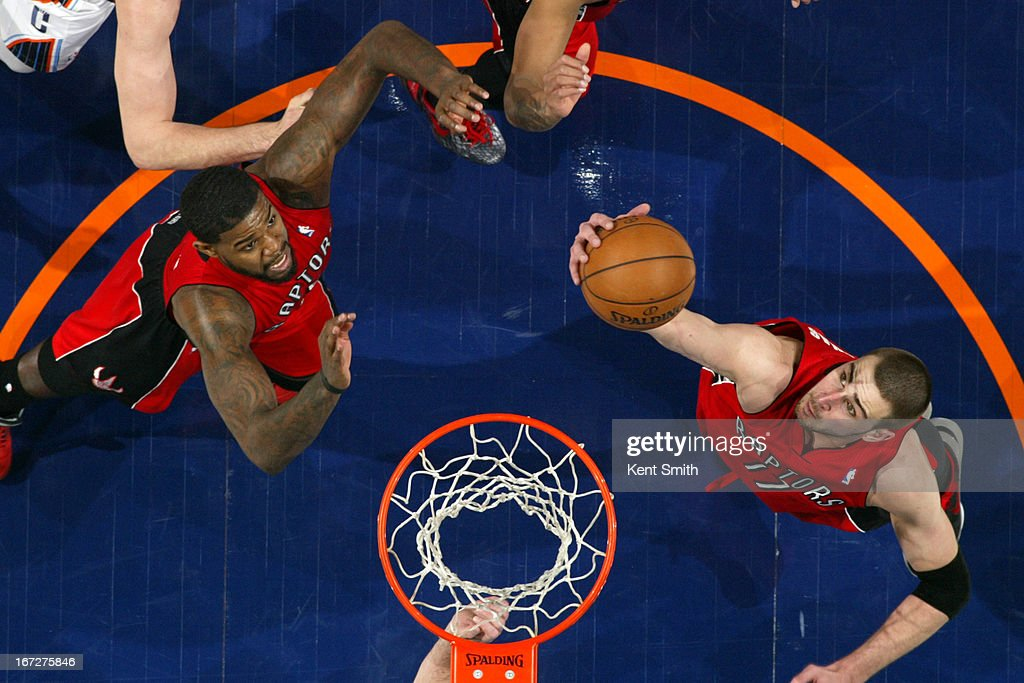 <a gi-track='captionPersonalityLinkClicked' href=/galleries/search?phrase=Jonas+Valanciunas&family=editorial&specificpeople=5654195 ng-click='$event.stopPropagation()'>Jonas Valanciunas</a> #17 of the Toronto Raptors goes up for a rebound against the Charlotte Bobcats at the Time Warner Cable Arena on March 20, 2013 in Charlotte, North Carolina.