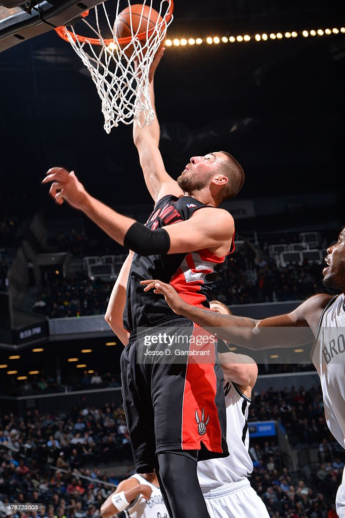 <a gi-track='captionPersonalityLinkClicked' href=/galleries/search?phrase=Jonas+Valanciunas&family=editorial&specificpeople=5654195 ng-click='$event.stopPropagation()'>Jonas Valanciunas</a> #17 of the Toronto Raptors goes up for a shot against the Brooklyn Nets on March 10, 2014 at the Barclays Center in Brooklyn, New York.