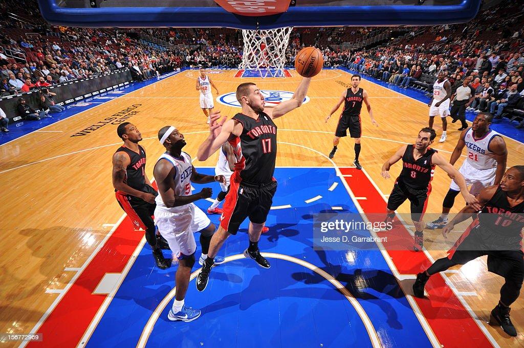 Jonas Valanciunas #17 of the Toronto Raptors grabs a rebound against the Philadelphia 76ers during the game at the Wells Fargo Center on November 20, 2012 in Philadelphia, Pennsylvania.