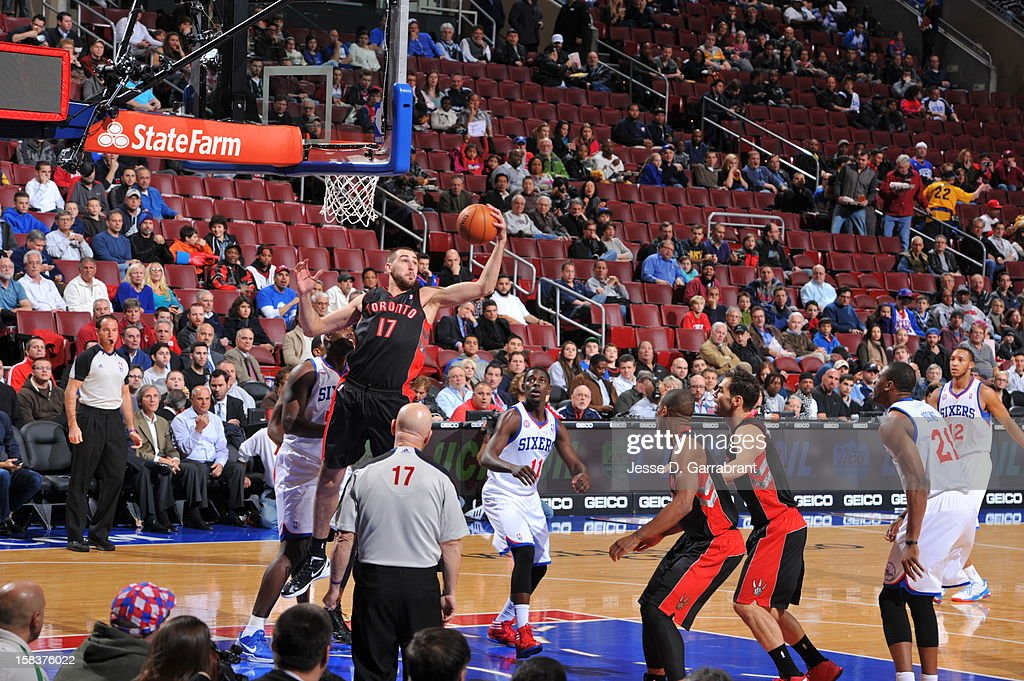 Jonas Valanciunas #17 of the Toronto Raptors grabs a rebound against the Philadelphia 76ers at the Wells Fargo Center on November 20, 2012 in Philadelphia, Pennsylvania.