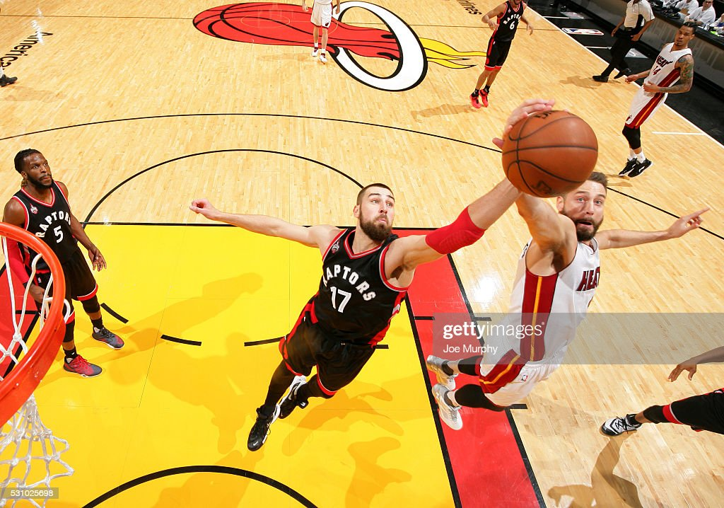 Jonas Valanciunas #17 of the Toronto Raptors grabs the rebound against Josh McRoberts #4 of the Miami Heat in Game Four of the Eastern Conference Semifinals during the 2016 NBA Playoffs on May 9, 2016 at American Airlines Arena in Miami, Florida.