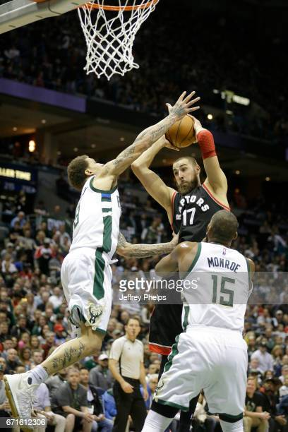Jonas Valanciunas of the Toronto Raptors grabs the rebound against the Milwaukee Bucks during Game Four of the Eastern Conference Quarterfinals of...