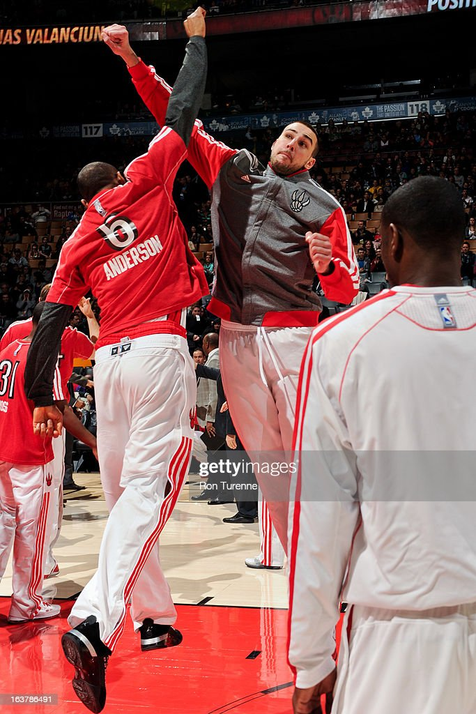 <a gi-track='captionPersonalityLinkClicked' href=/galleries/search?phrase=Jonas+Valanciunas&family=editorial&specificpeople=5654195 ng-click='$event.stopPropagation()'>Jonas Valanciunas</a> #17 of the Toronto Raptors greets teammate <a gi-track='captionPersonalityLinkClicked' href=/galleries/search?phrase=Alan+Anderson&family=editorial&specificpeople=3945355 ng-click='$event.stopPropagation()'>Alan Anderson</a> #6 before a game against the Charlotte Bobcats on March 15, 2013 at the Air Canada Centre in Toronto, Ontario, Canada.