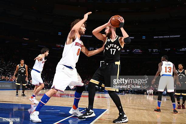 Jonas Valanciunas of the Toronto Raptors handles the ball against Robin Lopez of the New York Knicks on April 10 2016 at Madison Square Garden in New...