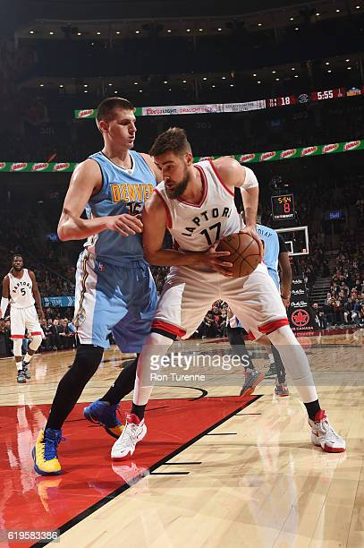 Jonas Valanciunas of the Toronto Raptors handles the ball against Nikola Jokic of the Denver Nuggets during a game on October 31 2016 at the Air...
