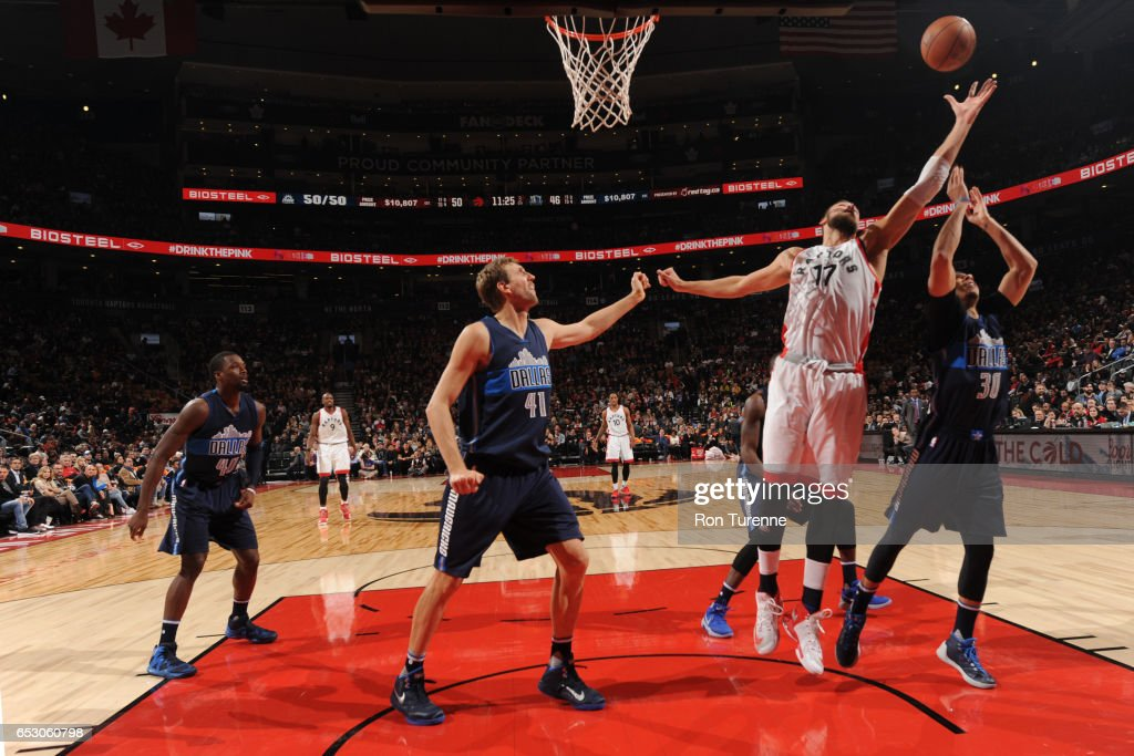 Jonas Valanciunas #17 of the Toronto Raptors jumps for the rebound against the Dallas Mavericks on March 13, 2017 at the Air Canada Centre in Toronto, Ontario, Canada.