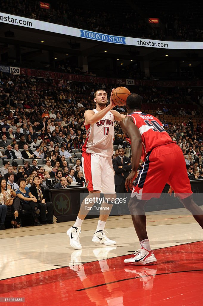<a gi-track='captionPersonalityLinkClicked' href=/galleries/search?phrase=Jonas+Valanciunas&family=editorial&specificpeople=5654195 ng-click='$event.stopPropagation()'>Jonas Valanciunas</a> #17 of the Toronto Raptors looks to shoot against <a gi-track='captionPersonalityLinkClicked' href=/galleries/search?phrase=Emeka+Okafor&family=editorial&specificpeople=201739 ng-click='$event.stopPropagation()'>Emeka Okafor</a> #50 of the Washington Wizards during a pre-season game on October 17, 2012 at the Air Canada Centre in Toronto, Ontario, Canada.