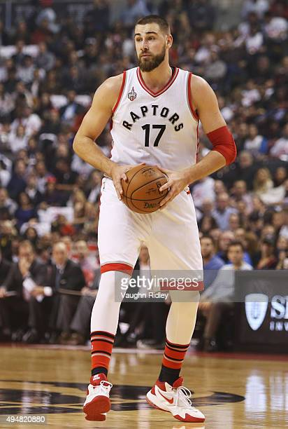 Jonas Valanciunas of the Toronto Raptors passes the ball during the NBA season opener against the Indiana Pacers at Air Canada Centre on October 28...