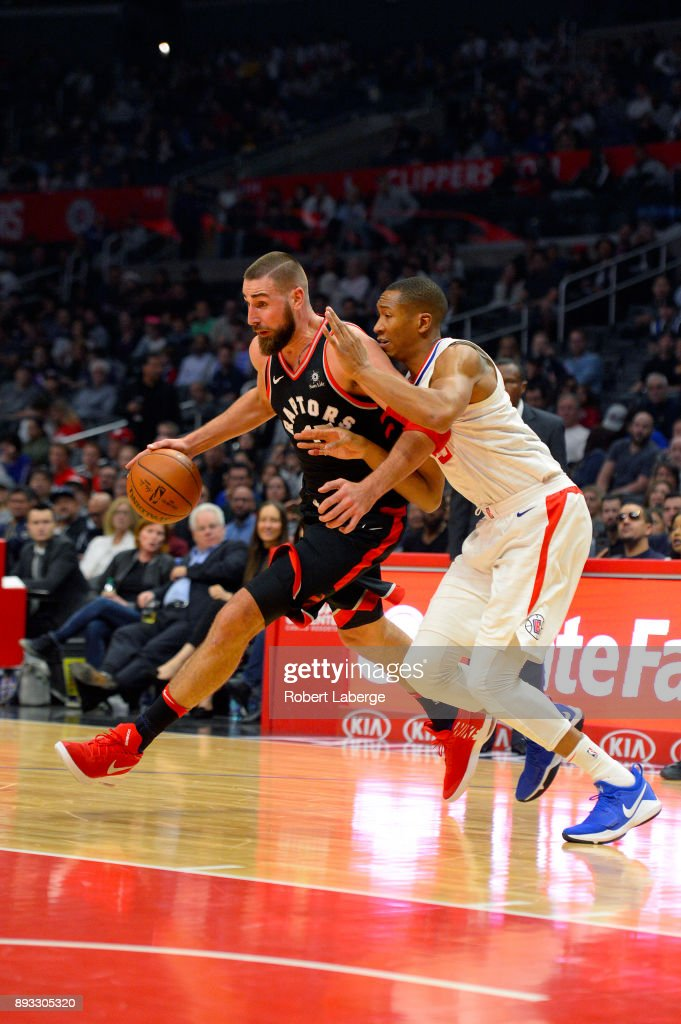 Jonas Valanciunas #17 of the Toronto Raptors plays against Wesley Johnson #33 of the Los Angeles Clippers on December 11, 2017 at STAPLES Center in Los Angeles, California.
