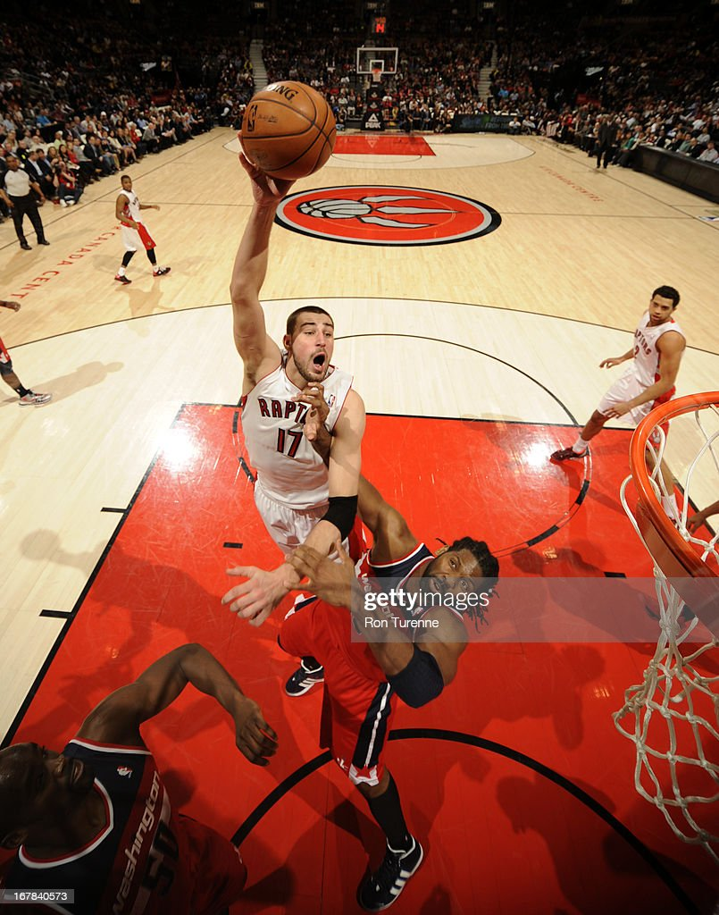 <a gi-track='captionPersonalityLinkClicked' href=/galleries/search?phrase=Jonas+Valanciunas&family=editorial&specificpeople=5654195 ng-click='$event.stopPropagation()'>Jonas Valanciunas</a> #17 of the Toronto Raptors puts up a shot against the Washington Wizards on April 3, 2013 at the Air Canada Centre in Toronto, Ontario, Canada.