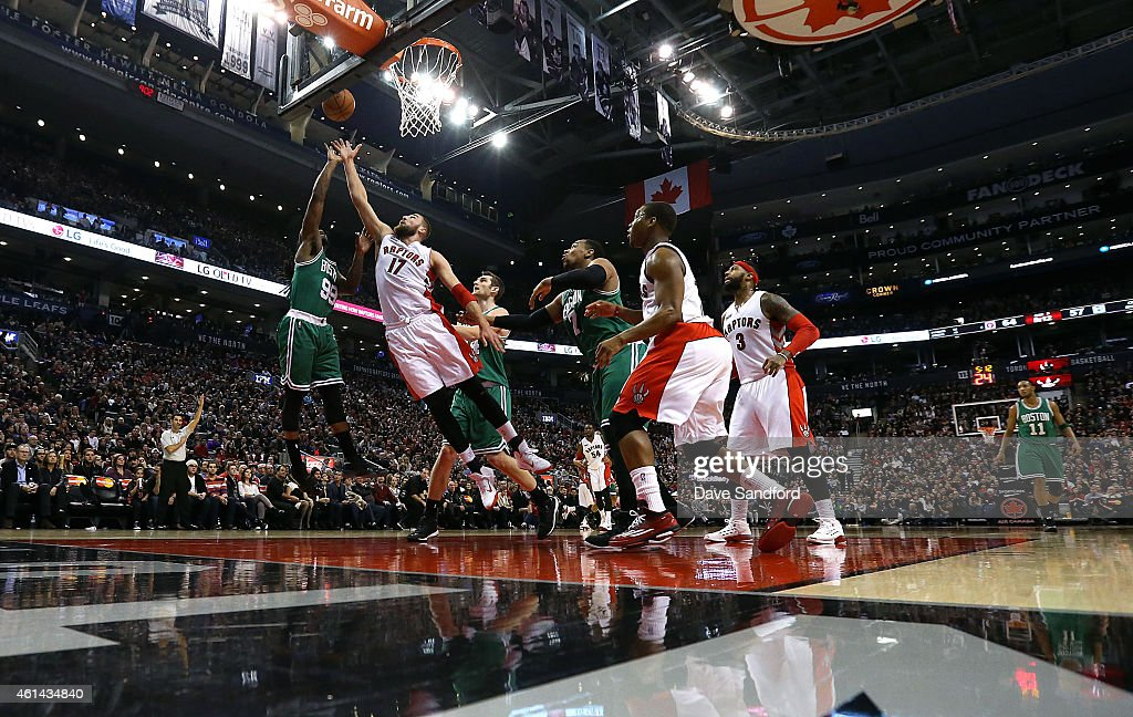 Jonas Valanciunas #17 of the Toronto Raptors reaches for the ball against Jae Crowder #99 of the Boston Celtics at the Air Canada Centre on January 10, 2015 in Toronto, Ontario, Canada.