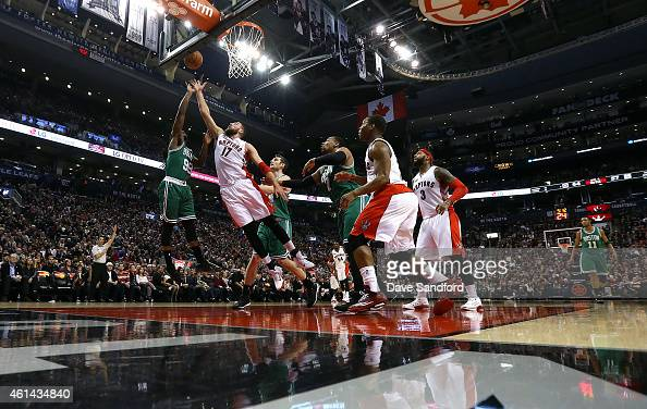 Jonas Valanciunas of the Toronto Raptors reaches for the ball against Jae Crowder of the Boston Celtics at the Air Canada Centre on January 10 2015...