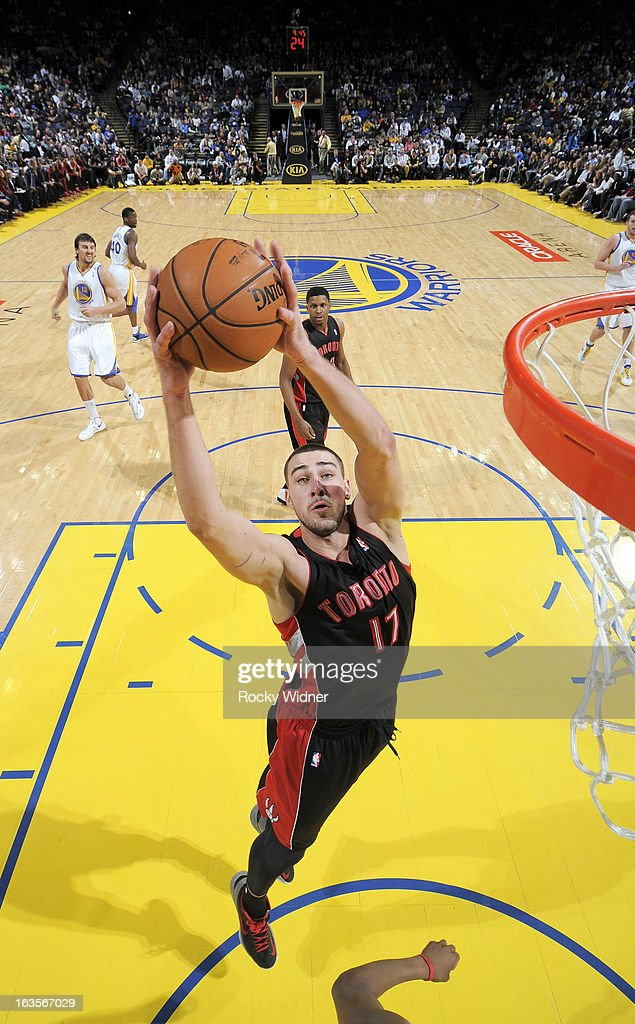 Jonas Valanciunas #17 of the Toronto Raptors rebounds against the Golden State Warriors on March 4, 2013 at Oracle Arena in Oakland, California.
