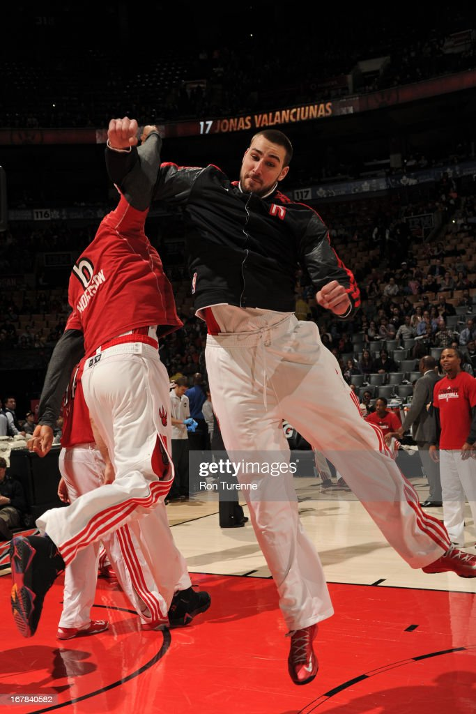 <a gi-track='captionPersonalityLinkClicked' href=/galleries/search?phrase=Jonas+Valanciunas&family=editorial&specificpeople=5654195 ng-click='$event.stopPropagation()'>Jonas Valanciunas</a> #17 of the Toronto Raptors runs out before the game against the Washington Wizards on April 3, 2013 at the Air Canada Centre in Toronto, Ontario, Canada.