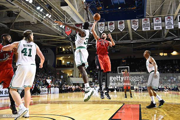 Jonas Valanciunas of the Toronto Raptors shoots against Brandon Bass of the Boston Celtics on October 15 2014 at the Cross Insurance Arena in...