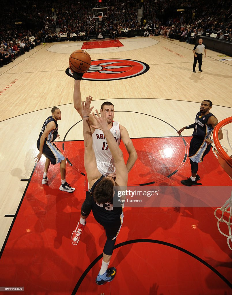 <a gi-track='captionPersonalityLinkClicked' href=/galleries/search?phrase=Jonas+Valanciunas&family=editorial&specificpeople=5654195 ng-click='$event.stopPropagation()'>Jonas Valanciunas</a> #17 of the Toronto Raptors shoots against <a gi-track='captionPersonalityLinkClicked' href=/galleries/search?phrase=Marc+Gasol&family=editorial&specificpeople=661205 ng-click='$event.stopPropagation()'>Marc Gasol</a> #33 of the Memphis Grizzlies on February 20, 2013 at the Air Canada Centre in Toronto, Ontario, Canada.