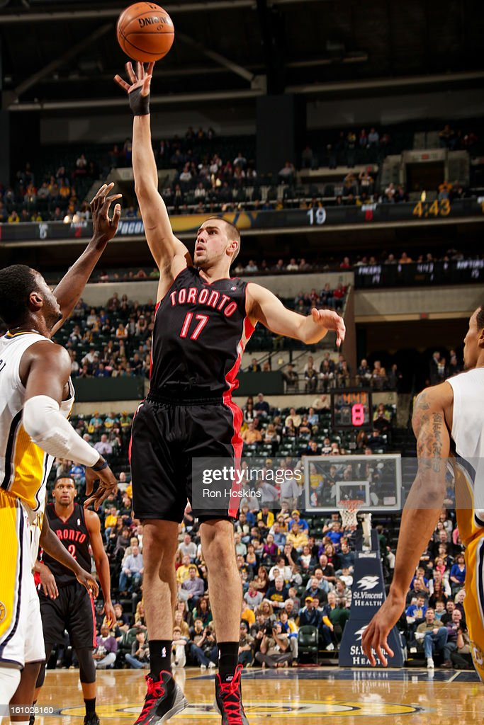 Jonas Valanciunas #17 of the Toronto Raptors shoots in the lane against Roy Hibbert #55 of the Indiana Pacers on February 8, 2013 at Bankers Life Fieldhouse in Indianapolis, Indiana.