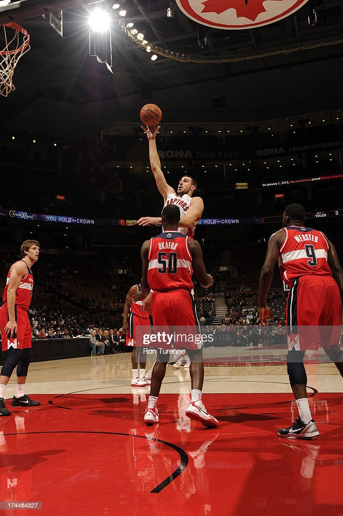 <a gi-track='captionPersonalityLinkClicked' href=/galleries/search?phrase=Jonas+Valanciunas&family=editorial&specificpeople=5654195 ng-click='$event.stopPropagation()'>Jonas Valanciunas</a> #17 of the Toronto Raptors shoots over <a gi-track='captionPersonalityLinkClicked' href=/galleries/search?phrase=Emeka+Okafor&family=editorial&specificpeople=201739 ng-click='$event.stopPropagation()'>Emeka Okafor</a> #50 of the Washington Wizards during a pre-season game on October 17, 2012 at the Air Canada Centre in Toronto, Ontario, Canada.