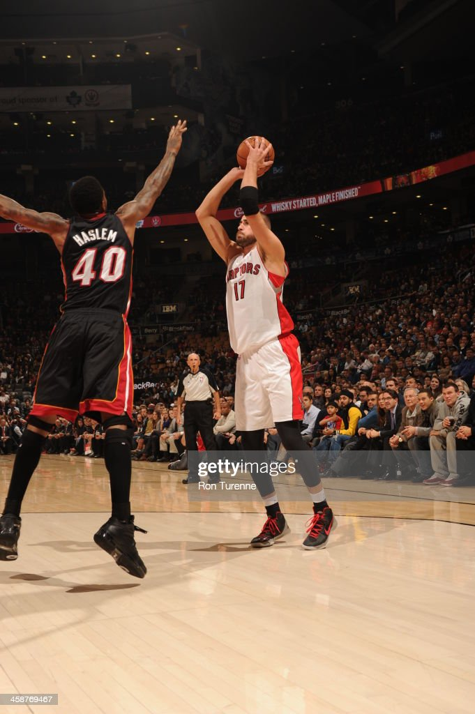 <a gi-track='captionPersonalityLinkClicked' href=/galleries/search?phrase=Jonas+Valanciunas&family=editorial&specificpeople=5654195 ng-click='$event.stopPropagation()'>Jonas Valanciunas</a> #17 of the Toronto Raptors shoots the ball against the Miami Heat during the game on November 5, 2013 at the Air Canada Centre in Toronto, Ontario, Canada.