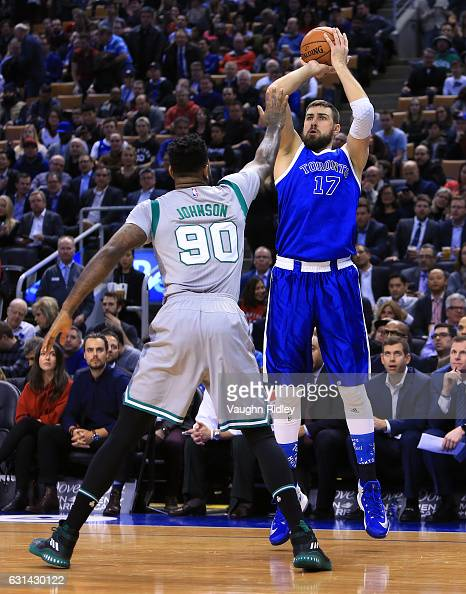 Jonas Valanciunas of the Toronto Raptors shoots the ball as Amir Johnson of the Boston Celtics defends during the first half of an NBA game at Air...