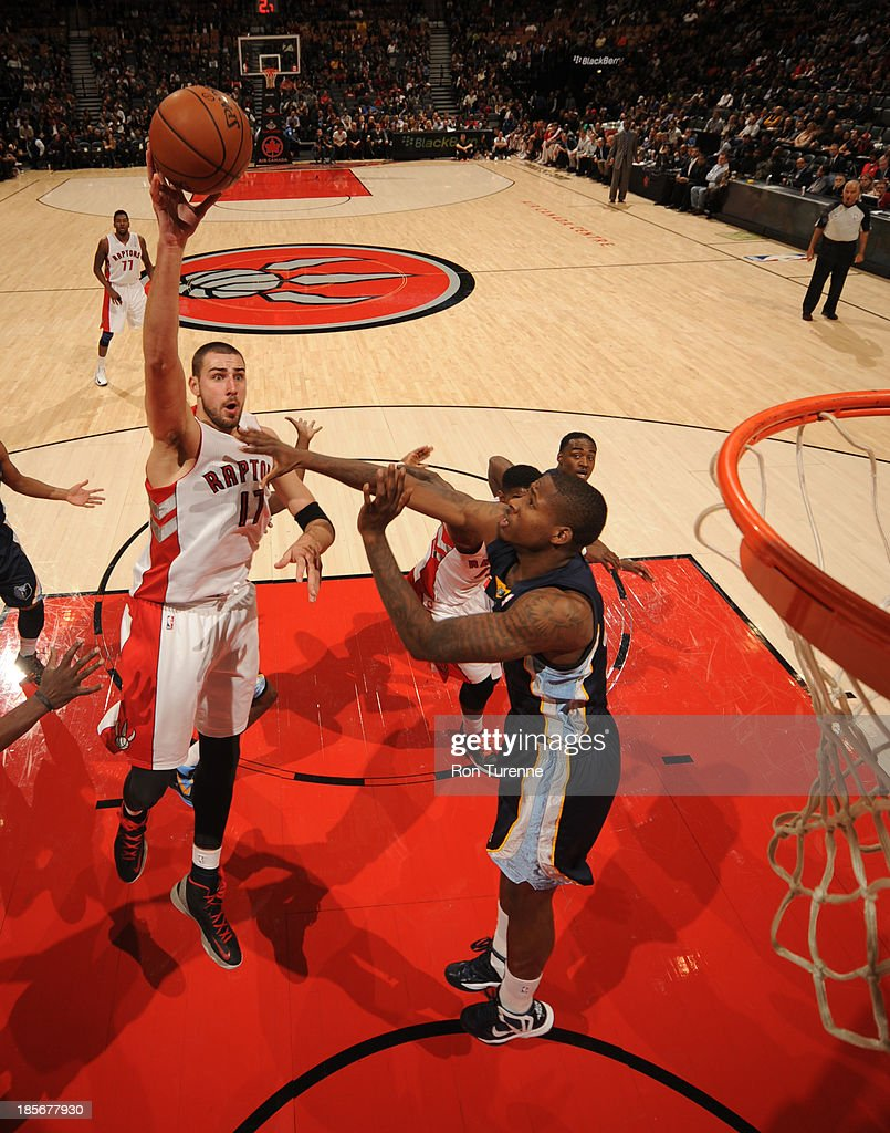<a gi-track='captionPersonalityLinkClicked' href=/galleries/search?phrase=Jonas+Valanciunas&family=editorial&specificpeople=5654195 ng-click='$event.stopPropagation()'>Jonas Valanciunas</a> #17 of the Toronto Raptors shoots the ball during the game against the Memphis Grizzlies on October 23, 2013 at the Air Canada Centre in Toronto, Ontario, Canada.