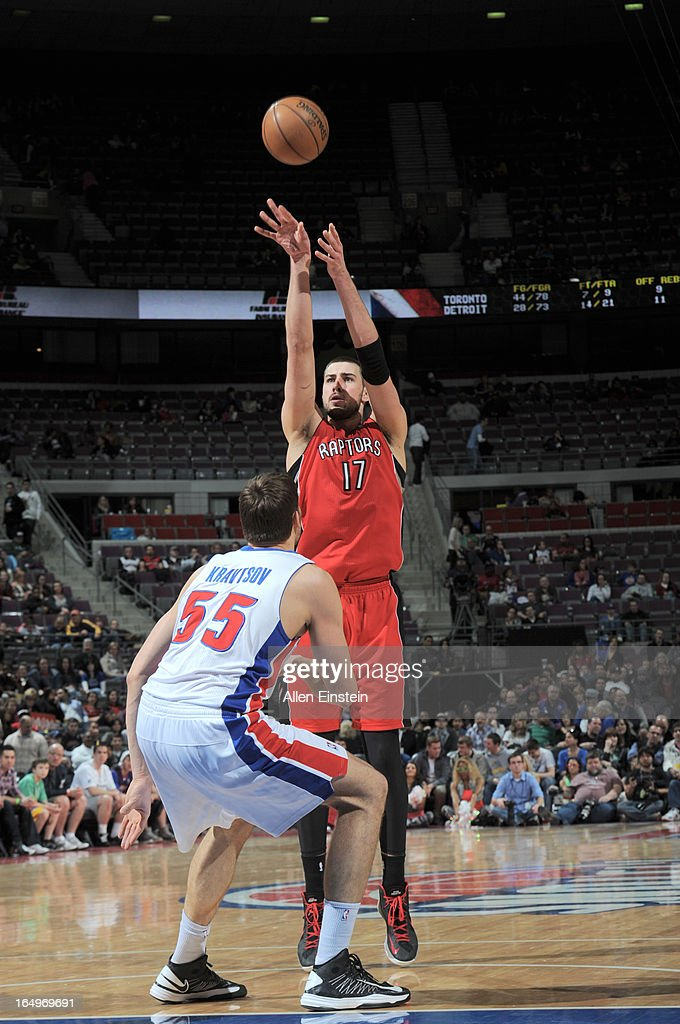 Jonas Valanciunas of the Toronto Raptors shoots the ball over Viacheslav Kravtsov of the Detroit Pistons during the game between the Detroit Pistons...