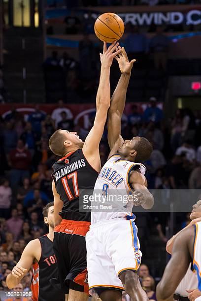 Jonas Valanciunas of the Toronto Raptors tips off against Serge Ibaka of the Oklahoma City Thunder during the NBA basketball game on November 6 2012...