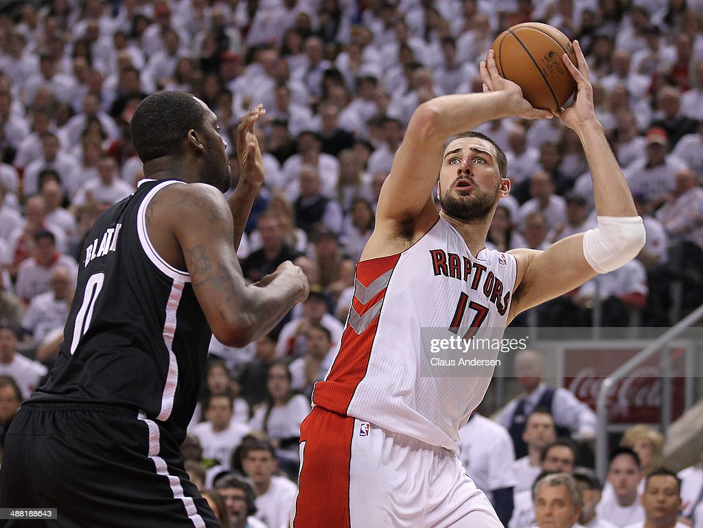 Jonas Valanciunas #17 of the Toronto Raptors tries to make a shot over Andray Blatche #0 of the Brooklyn Nets in Game Seven of the NBA Eastern Conference Quarterfinals at the Air Canada Centre on May 4, 2014 in Toronto, Ontario, Canada. The Nets defeated the Raptors 114-113 to win the series 4-3.