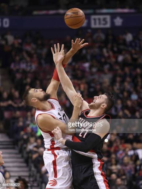 Jonas Valanciunas of the Toronto Raptors wins the opening tipoff against Jusuf Nurkic of the Portland Trail Blazers during NBA game action at Air...