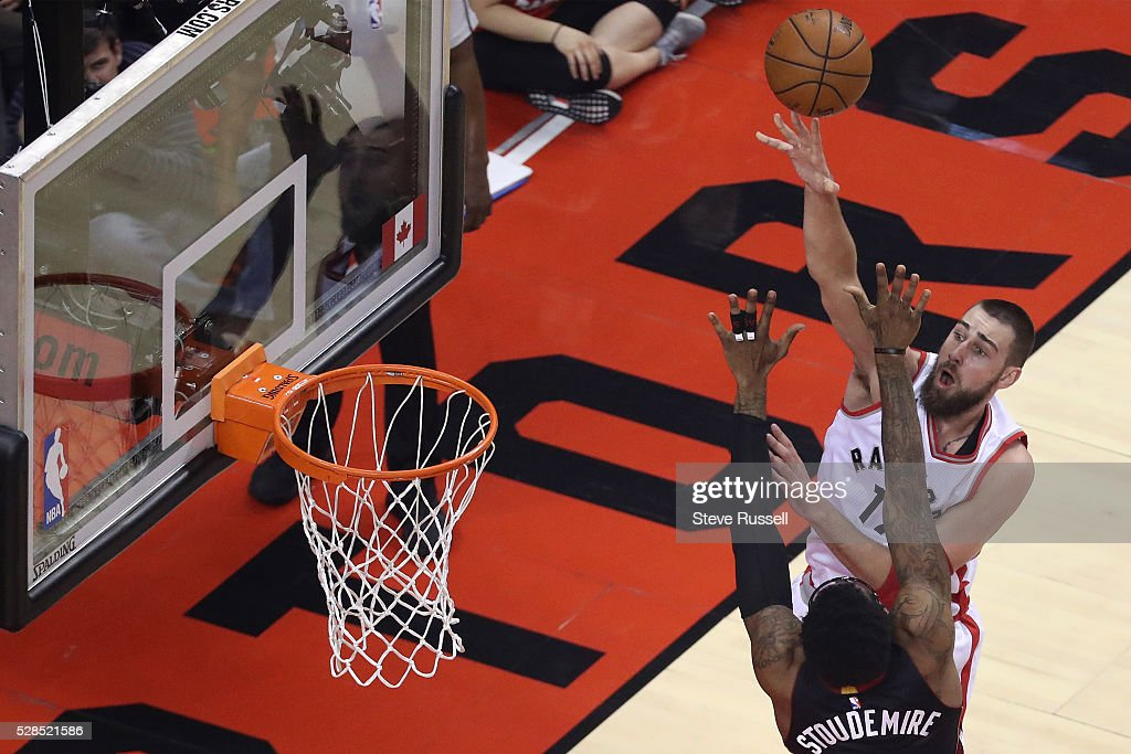 Jonas Valanciunas puts the ball over Amar'e Stoudemire as the Toronto Raptors play the Miami Heat in game two of their Eastern Conference Semifinal at the Air Canada Centre in Toronto. May 5, 2016.