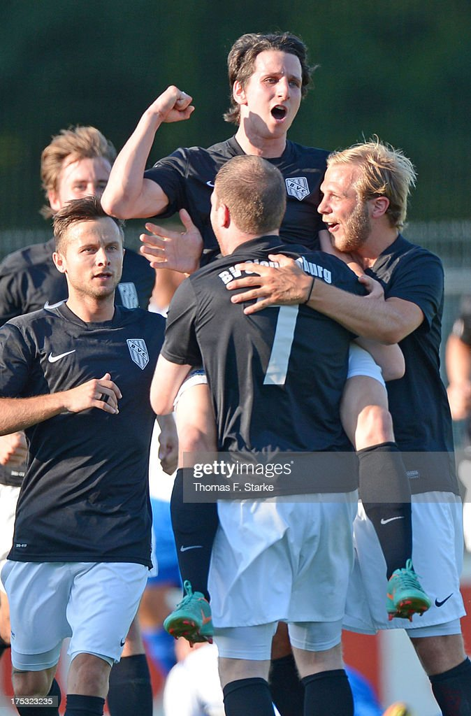 Jonas Wangler (TOP C) of Cloppenburg celebrates with his teammates during the Regionalliga North match between BV Cloppenburg and Goslarer SC at stadium Cloppenburg on August 2, 2013 in Cloppenburg, Germany.