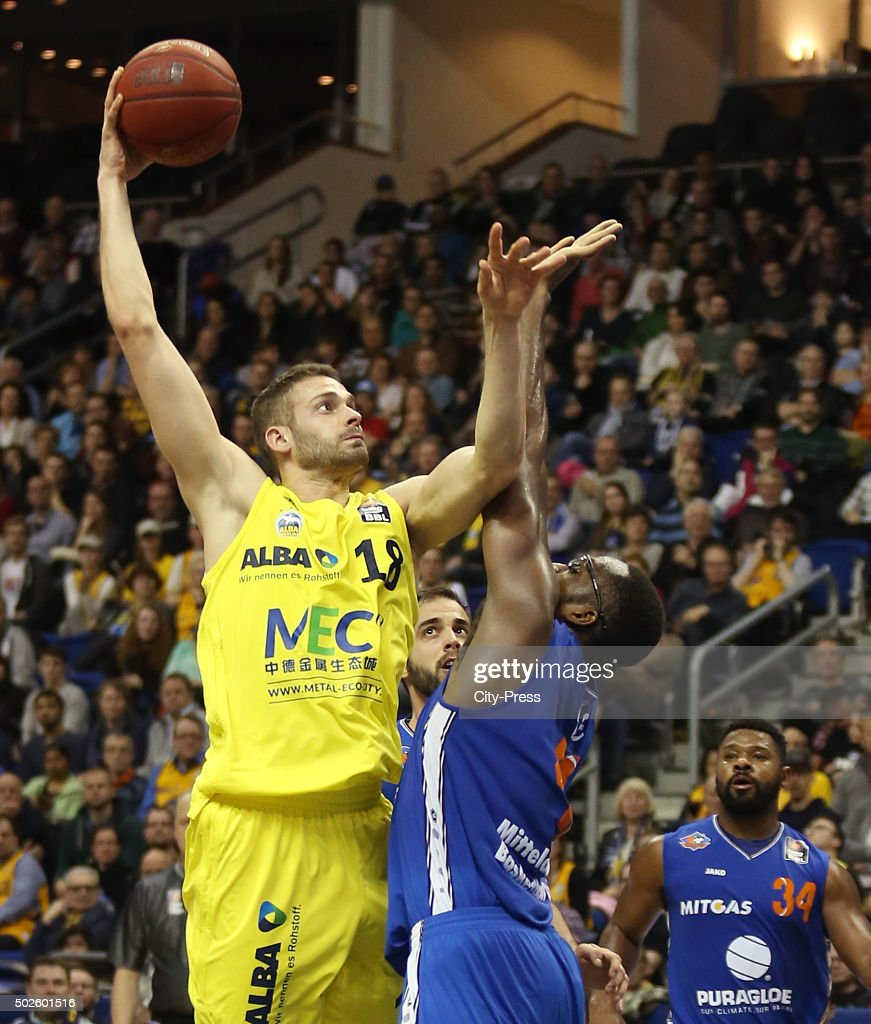 Jonas Wohlfarth-Bottermann of ALBA Berlin and <a gi-track='captionPersonalityLinkClicked' href=/galleries/search?phrase=Chris+Otule&family=editorial&specificpeople=5678342 ng-click='$event.stopPropagation()'>Chris Otule</a> of Mitteldeutscher BC during the game between Alba Berlin and Mitteldeutscher BC on December 27, 2015 in Berlin, Germany.
